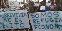 Испания: в Барселоне помогут иммигрантам